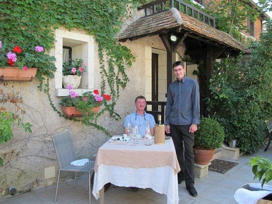 Auberge du Bon Laboureur :                   Lovely vine-covered terrace and attentive service at Le Bon Laboureur