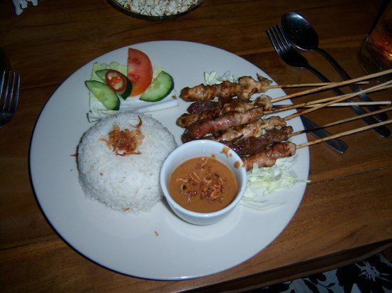 New Queen Pub & Restaurant :                   Mixed sate (beef, chicken and pork). Tender, flavorful and moist!
