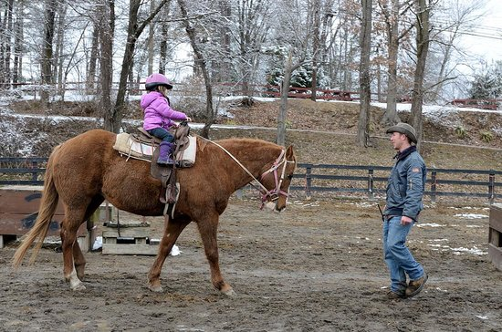 Pinegrove Family Dude Ranch:                   EJ instructs our daughter.
