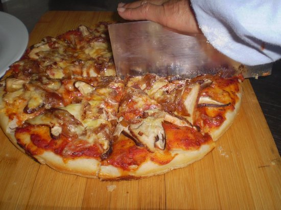 Slice of Heaven: pork sausage, porcini mushroom and onion jam pizza New Zealand cheddar cheese. Very popular