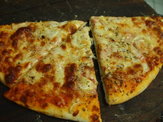 Pizza with onions at the Italian Job restaurant in Port Antonio, Jamaica.