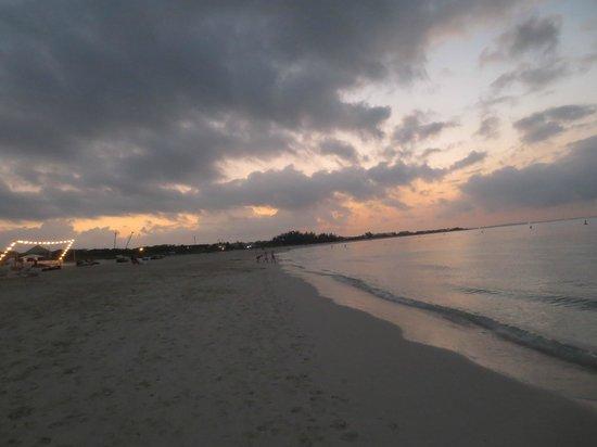 Gansevoort Turks + Caicos:                   Sunset - beachfront dining being set up in front of Gansevoort