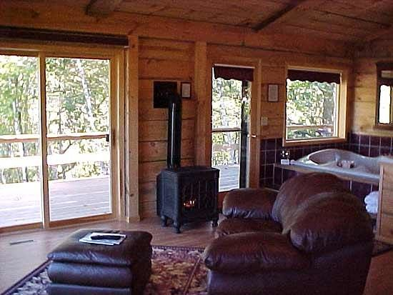 Percheron Paradise Romantic Hideaway: Bungalow fireplace and wrap arround deck