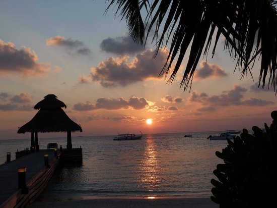 Baros Maldives:                   Sunset by the arrival/departure jetty