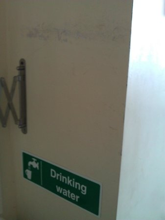 The Pineapple Hotel:                   marks on wall & sign letting us know the tap water is ok to drink!!???