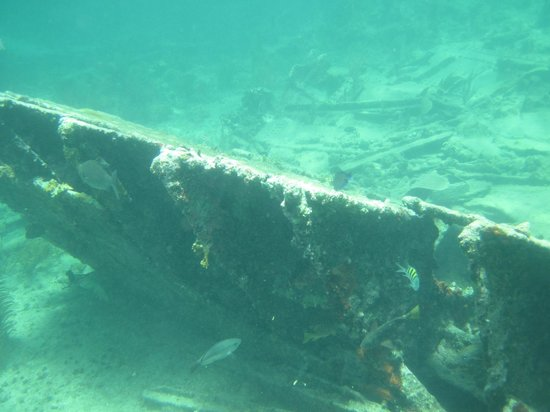 A sunken ship remains in Playa Pilar