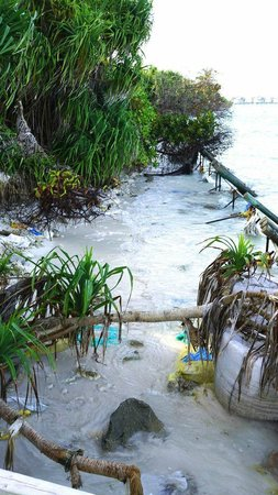 Six Senses Laamu:                                     erosion in front of Lagoon beach villas