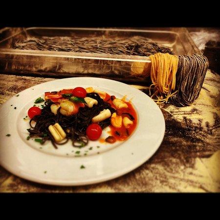 Pappa Ciccia-Fulham High Street:                                     Sea food tagliolini , trattoria autentica, despite some peop