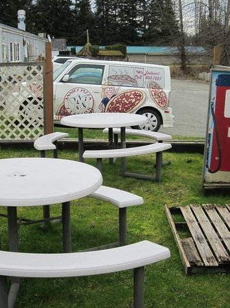 Annie's Pizza Station:                   Outdoor seating and the delivery 'van'