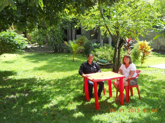La Antigua:                   Backyard tables a tropical garden setting