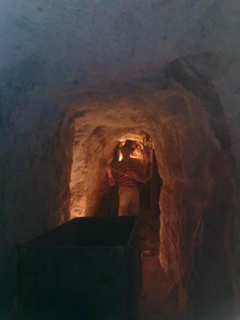Calico Ghost Town:                                     Mine inside the mountain, a mannequin of a convict mining fo