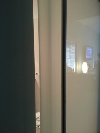 Kimpton Lorien Hotel & Spa :                                     Another gap view into bathroom from the door