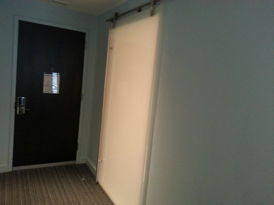 Kimpton Lorien Hotel & Spa :                                     Frosted barn style door to the bathroom