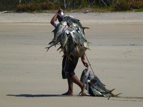 Occidental Tamarindo:                   Local Fisherman walking towards resort