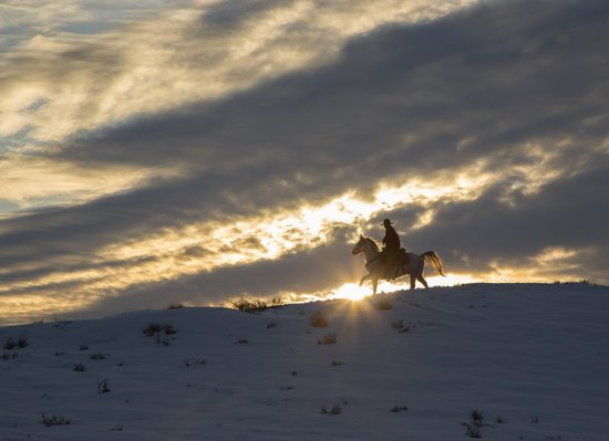 The Hideout Lodge & Guest Ranch:                   Tom rides into the Sunset