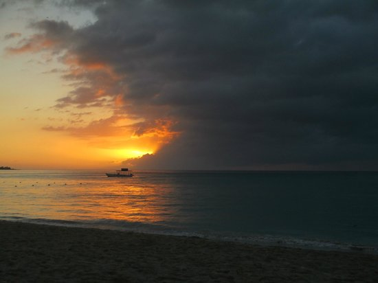 Hidden Paradise Resort Hotel:                   Love those Negril colorful sunsets