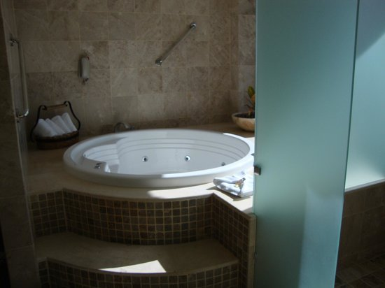 Sheraton Buganvilias Resort & Convention Center:                                     Large Private Jacuzzi Tub - Sliding Door Opens to the Balcon