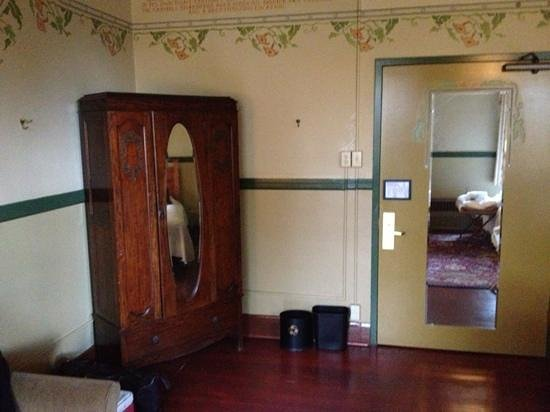 McMenamins Edgefield:                   dresser and door.  this room does not have a sink.