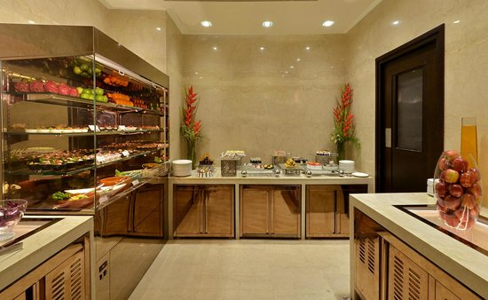 Hilton Garden Inn Gurgaon Baani Square: The salad and dessert counters of Glass House, the all-day dining world-cuisine restaurant .