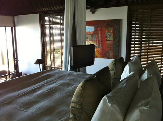 The Nam Hai Hoi An - a GHM hotel:                                     TV next to the bed