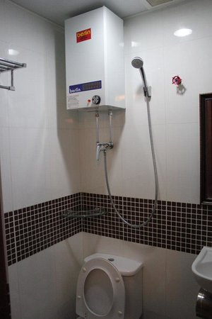 Day and Night Hotel:                   Combined shower/ toilet.