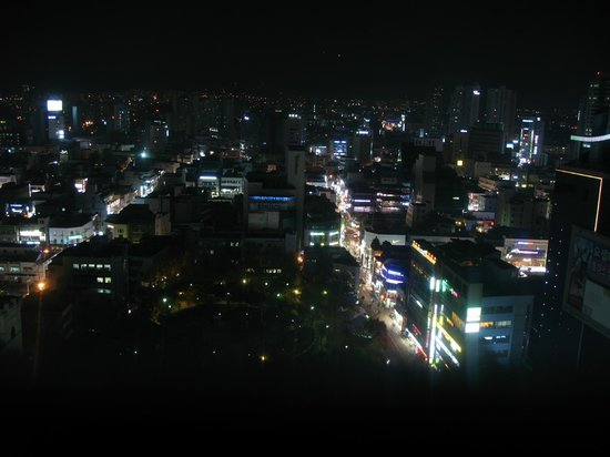 Novotel Ambassador Daegu:                                     Looking out over downtown at night.