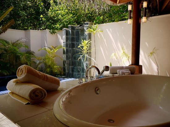 Huvafen Fushi Maldives:                   beach bungalow bathroom and plunge pool