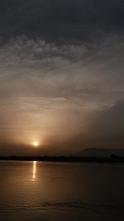 Hilton Luxor Resort & Spa:                   Sunset over Nile river and Valley of the Kings