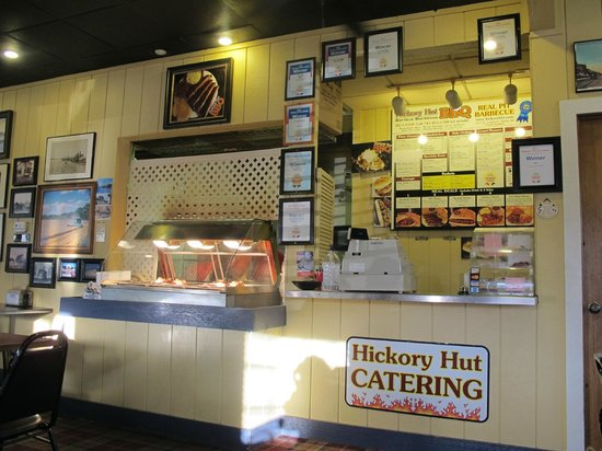 Hickory Hut Barbeque:                   order window with BBQ meat in heater