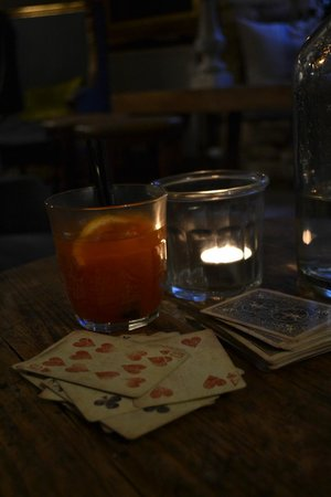The Lion Inn:                   Playing cards by the fire with a champagne cocktail