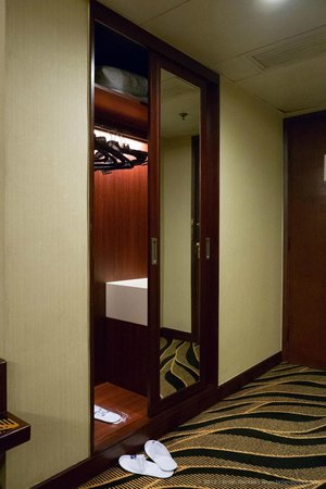 Metropark Hotel Kowloon:                   Wardrobe with safe.