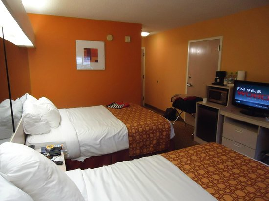 Microtel Inn & Suites by Wyndham Palm Coast:                   Room #119 - Photo from far wall. Micro, Coffee maker, Fridge