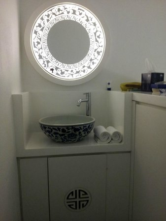 The Porcelain Hotel:                                     Hotel's signature mirror