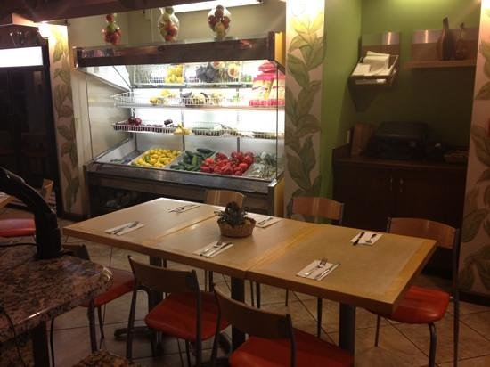 Julio's Natural Foods Restaurant :                   Produce fridge in dining area.