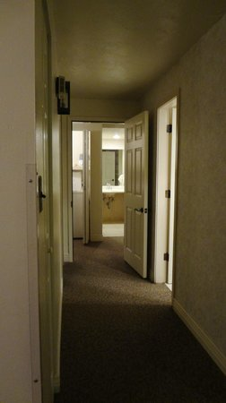 Sandstone Creek Club:                   Looking down the hallway to the 2 bedrooms from the kitchen