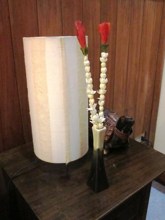 Kambuja Inn:                   fragrant flowers on the bedside table