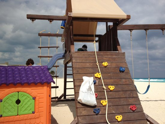 The Ritz-Carlton, Cancun :                   There's a play set at the end of the property. Great for a windy day!