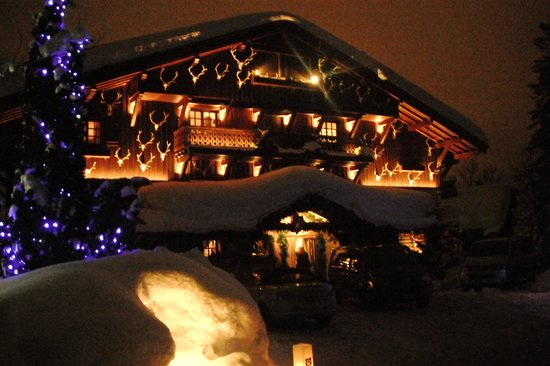 Chalet du Mont d'Arbois :                   Chalet at night. Nice light effect on all those antlers!