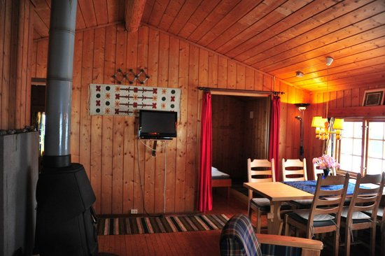 Nedre Strand Hytteutleige:                   On the left, the bedroom with red curtains and sliding door  (cabin 5)