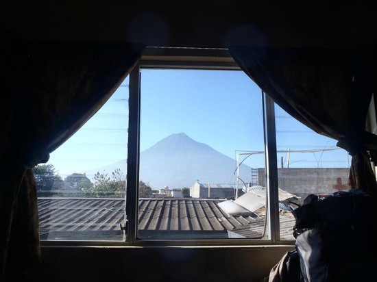 Hotel Los Nazarenos :                                                       Great volcano view from our room on the 2n