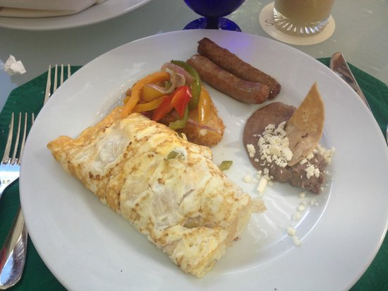 Secrets Aura Cozumel:                   big portions for breakfast - omelet and sausage