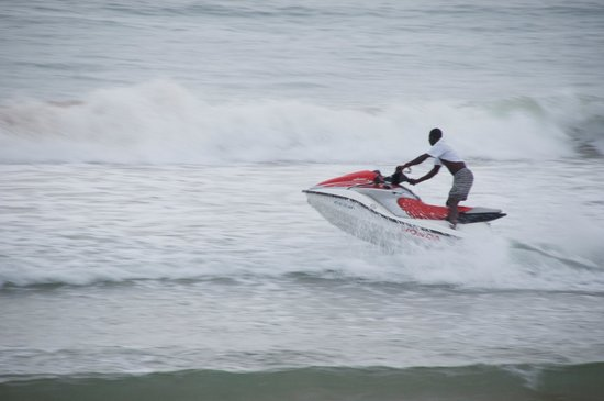 Busua Beach Resort:                   A GUEST HAVING FUN ON A JET SKI
