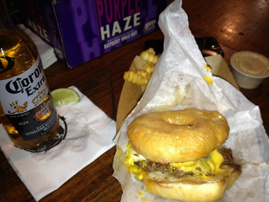 Jack Brown's Beer & burger Joint :                   The Showalter-glazed donut bun, burger, bacon ,cheese and fried egg-yum!