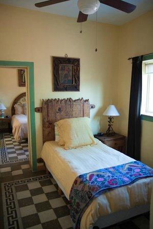 Casa Venezuela:                   One of the bedrooms with two available beds