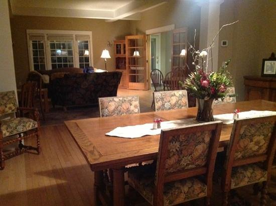 The Inn at Ellsworth Estate:                   Dining room overlooking one of the living rooms w fireplace.