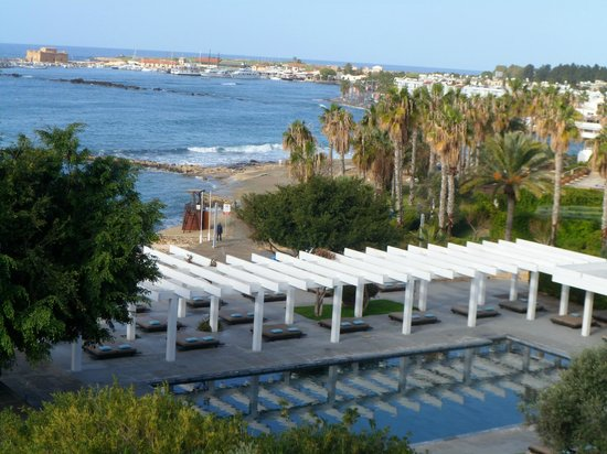 Almyra Hotel:                   View from 4th floor room of paphos harbour & fort