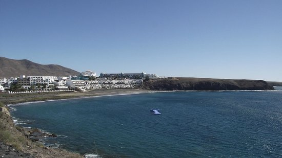 Sandos Papagayo Beach Resort:                   View of complex from Playa Blanca promenade