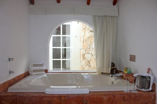 El Dorado Casitas Royale, by Karisma:                   Casita Suite Jacuzzi looking onto Outdoor Shower