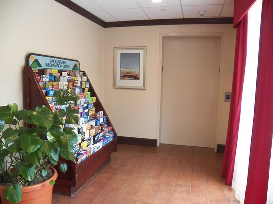 Hampton Inn Asheville - Tunnel Road:                   travel info can be found by the main lobby elevator