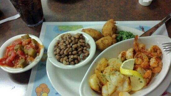 Corky Bell's Seafood:                   Shrimp and scallops dinner, blackened. Sides were; tomatoes and okra, blackeye